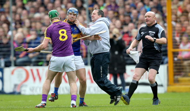 Davy Fitzgerald and Aidan Nolan clash with Jason Forde