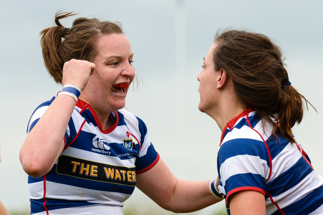 Carmela Morey scores a try and celebrates with Carrieann Hanley