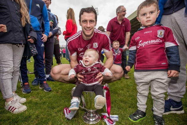 Galway captain David Burke celebrate winning the Division 1 trophy with  his neice, 7 month old Thea Burke and nephew, 3 year old Freddie Burke