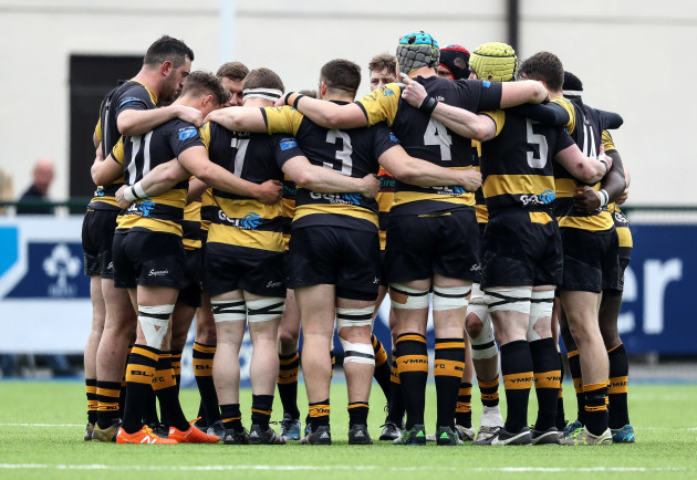 Young Munster's team huddle