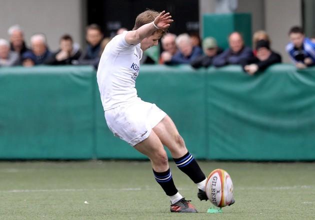 Tomas Quinlan kicks the winning penalty