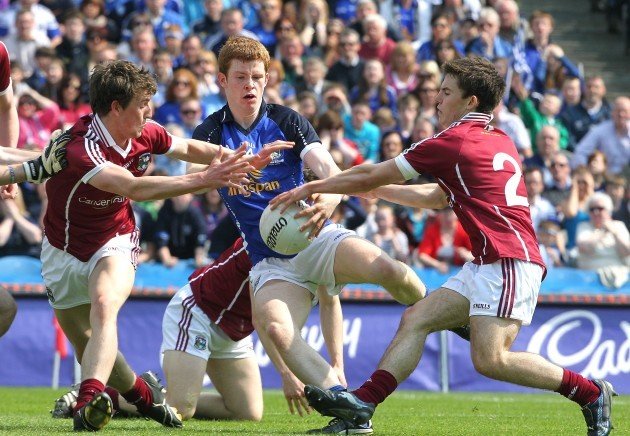 Niall McDermott tackled by Joss Moore and Gary Sweeney