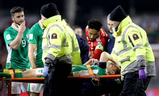 Seamus Coleman leaves on a stretcher