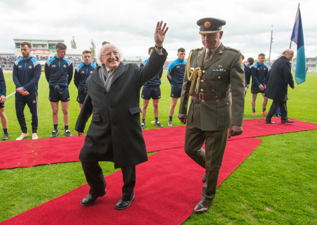 Michael D Higgins attends the game