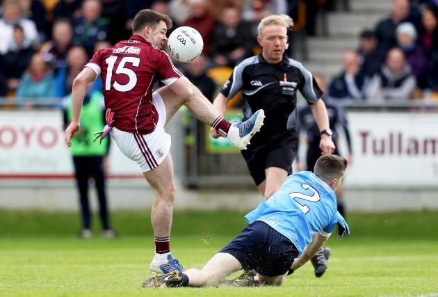 Dessie Connelly has a shot blocked by Darren Byrne