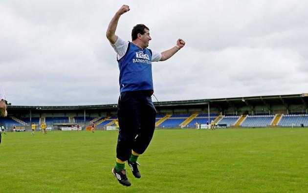 Michael Naughton celebrates at the final whistle