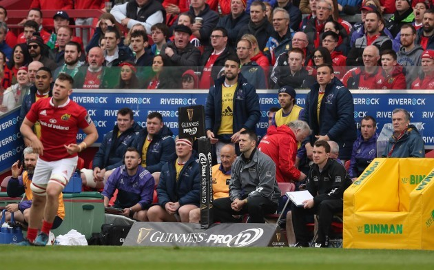 MunsterÕs Conor Murray looks on from the bench