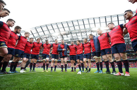 Munster players huddle after the game