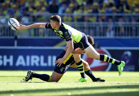 Garry Ringrose offloads in the tackle