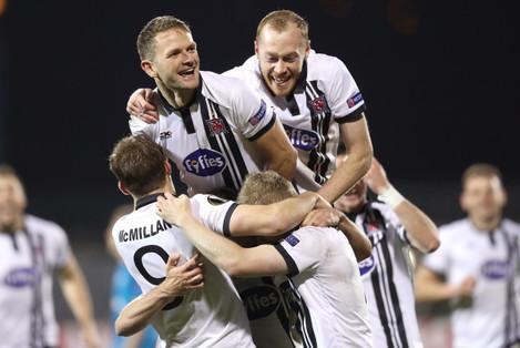 Robbie Benson celebrates his goal with teammates