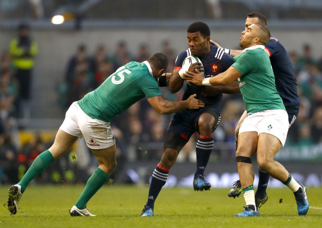 Noa Nakaitaci is tackled by Rob Kearney and Simon Zebo