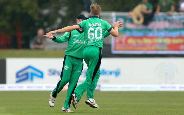 Barry McCarthy celebrates taking a wicket