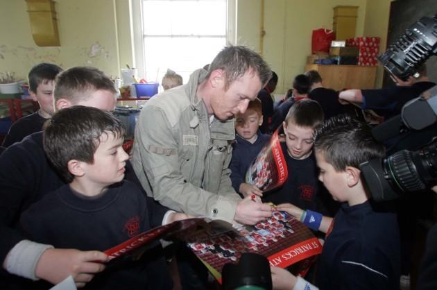 Trevor Molloy signs autographs