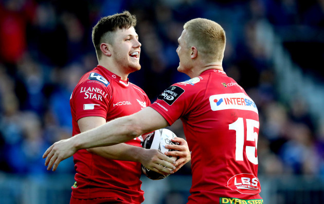 Steff Evans celebrates scoring a try with Johnny McNicholl