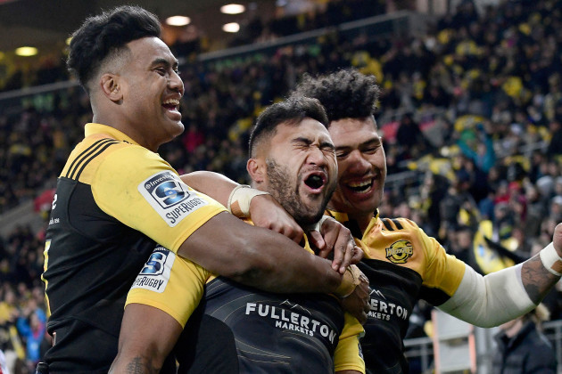 Vince Aso celebrates his try with Julian Savead and Ardie Savea