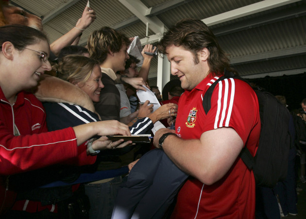 Shane Byrne signs autographs for fans after arriving