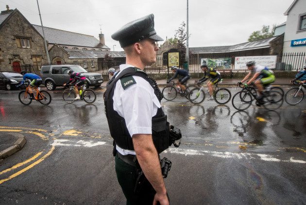 A PSNI Officer looks on as the Ras as it makes its way through Lisnaskea