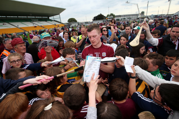 Joe Canning signs autographs after the game