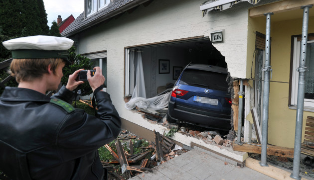 Car crashed through wall of house