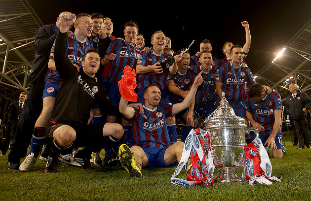 The Pat's team celebrate with the trophy