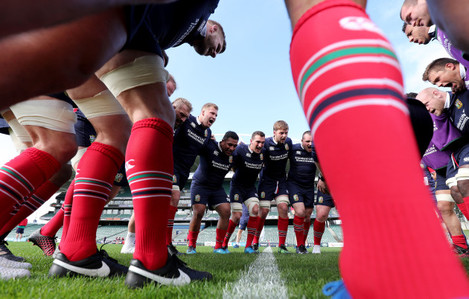 The forwards in a team huddle