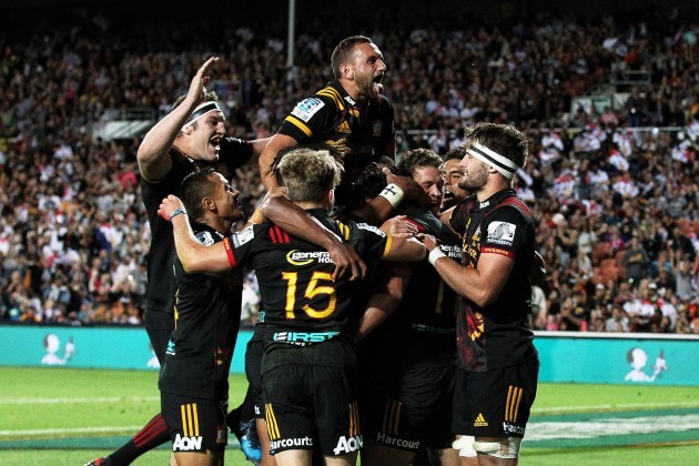 Chiefs players celebrate scoring a try