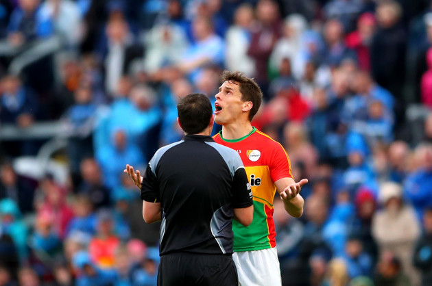 Brendan Murphy dejected after receiving a red card