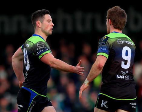 John Cooney celebrates his try with Kieran Marmion