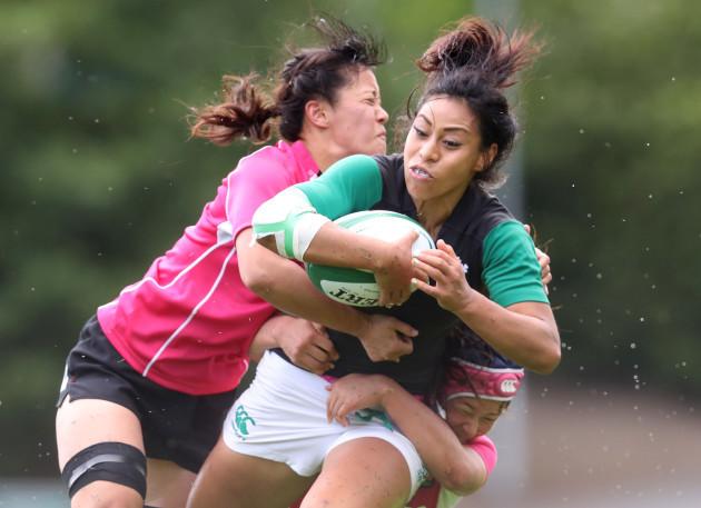 Sene Naoupu is tackled by Iroha Nagata and Ayaka Suzuki