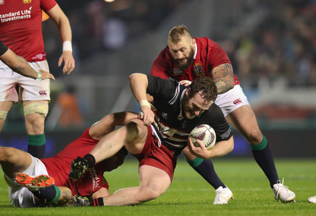 Oliver Jager is tackled by Joe Marler