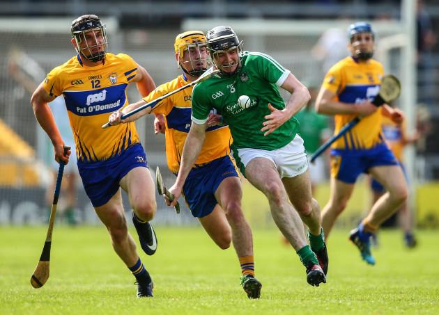Declan Hannon under pressure from John Conlon and Colm Galvin