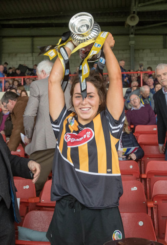 Meighan Farrell lifts the Division 1 trophy