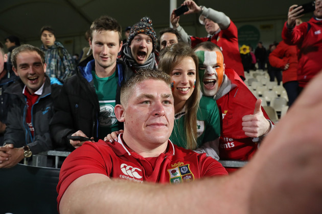 Tadhg Furlong poses for a selfie with fans after the game