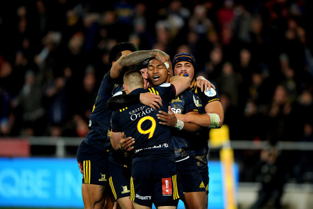 Waisake Naholo celebrates scoring their first try with teammates