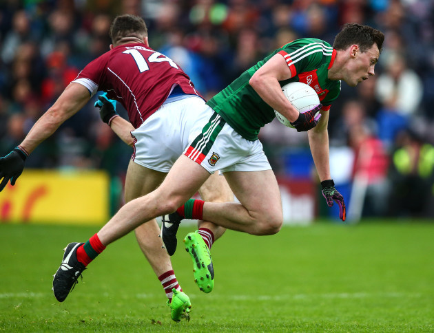 Damien Comer with a shoulder tackle on Diarmuid O'Connor