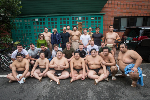 Ireland players and management pose for a photo with Sumo Wrestlers