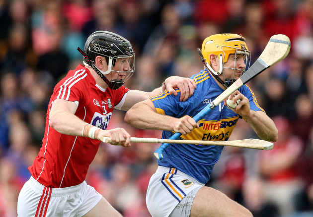 Seamus Callanan is tackled by Damian Cahalane