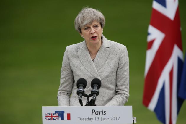 Theresa May visits Paris