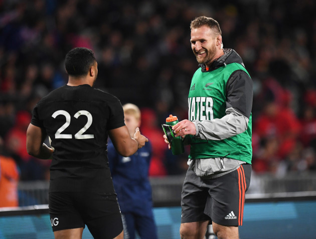 Kieran Read hands a water bottle to Lima Sopoaga