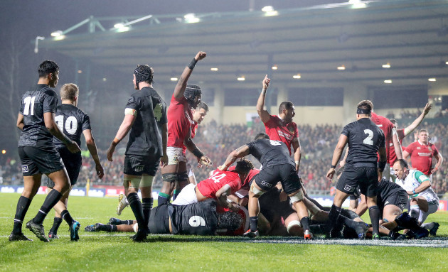 Lions' players celebrate a Jamie George try that was ruled by the TMO as inconclusive