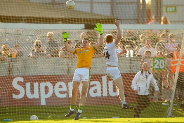 Daniel Flynn scoring his sides second goal past goalkeeper Paddy O'Rourke