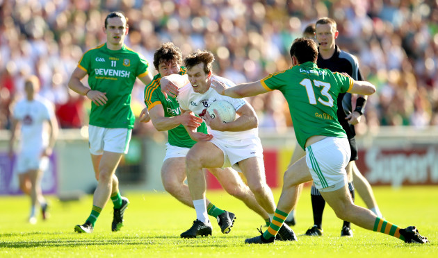 Pauric Harnan and Graham Reilly tackle Paddy Brophy