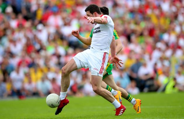 Sean Cavanagh takes a shot on goal