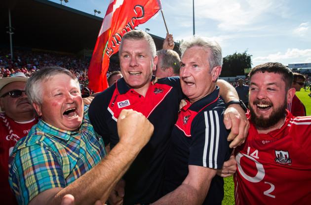 Kieran Kingston and assistant manager Diarmuid O'Sullivan celebrates at the final whistle