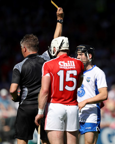 Jamie Barron is yellow carded by Barry Kelly