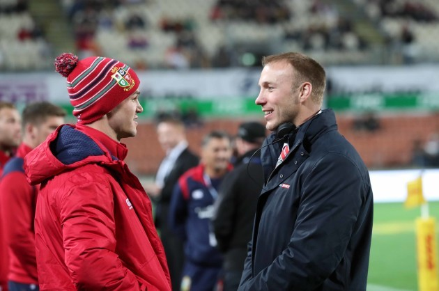 Jonathan Sexton speaks with Stephen Ferris before the game