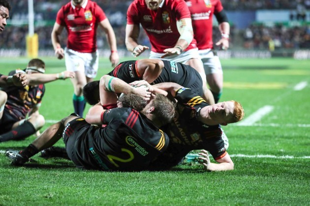 Iain Henderson is held up over the line as the team are awarded a penalty try