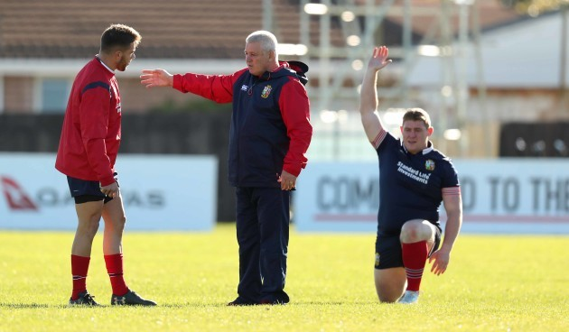 Head Coach Warren Gatland talks to Rhys Webb with Tadgh Furlong in the background during the Captains Run