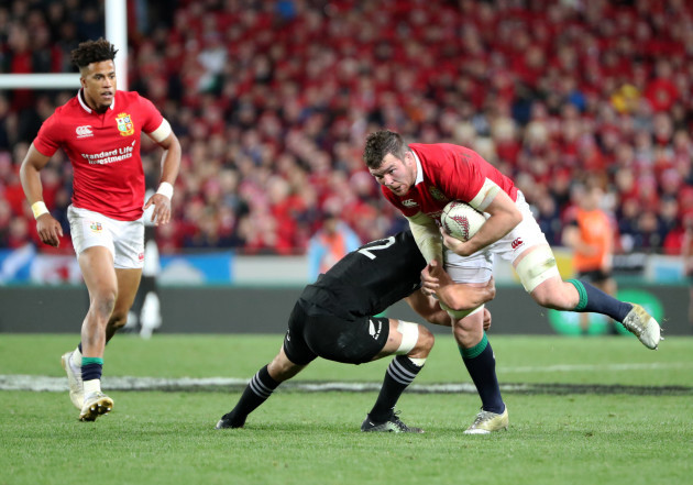Peter O'Mahony is tackled by Sonny Bill Williams