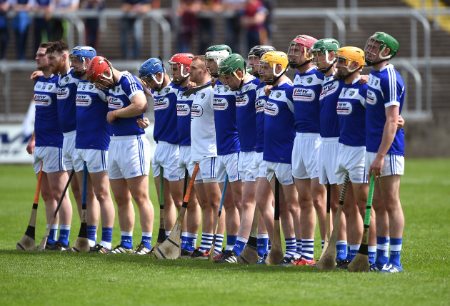 Laois players stand for the national anthem